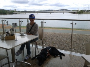 Enjoying a coffee at the cafe of the National Museum with Wiley lying by my chair